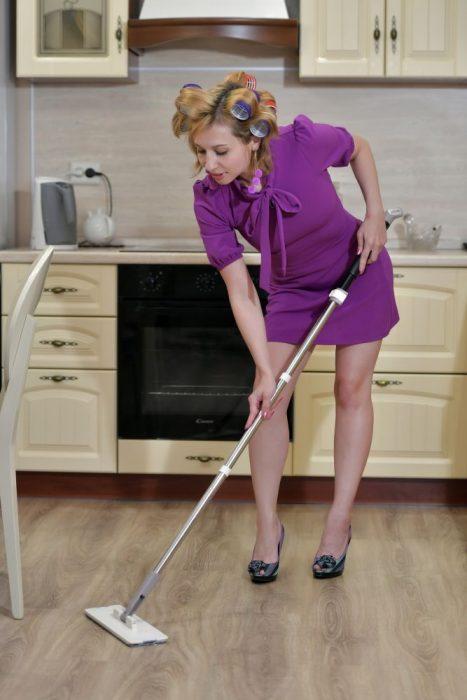 scrubbing dirty kitchen floor